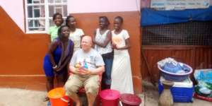 Group of beneficiaries with buckets and soap