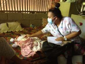 Midwife at home visit for new baby