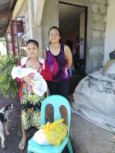New mothers with food gift brought to their door