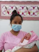 Mother with new baby after birth