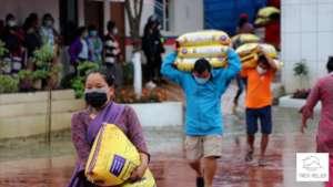 Distributing relief food for trekking porters