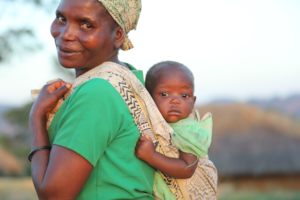 Mother and child at home visit in Malawi