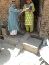 Our field team member distributing food