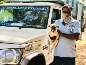 TOLFA ambulance driver with a recovered puppy