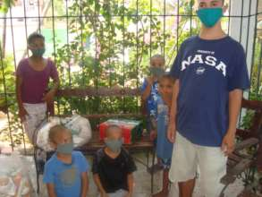 Kids wear protective masks for first time.