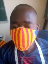 Ousmane with his mask
