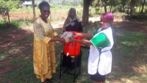 Handing over of soap and hand washing station