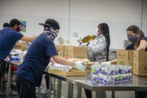 Volunteers assembling food boxes