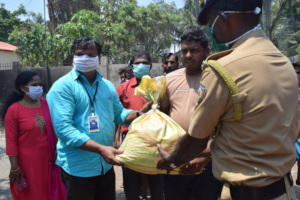 Don Bosco officials handing over the food kits