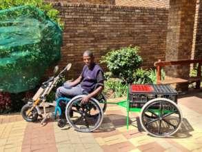 E-Wheelchair with trailer.