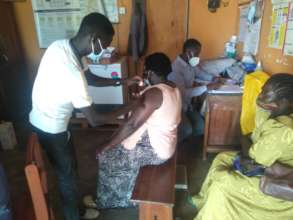 Agwata community members getting vaccine shots