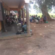 Agwata clinic patients waiting in line - late May
