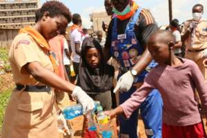 Scouts distributing soap to community members