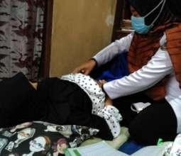 A nurse checks a pregnant woman