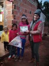 Fundacion Paraguaya's staff delivering donations
