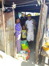 Migrant worker family with relief kit in Bangalore