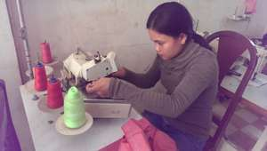 Chantha Learns to Sew!