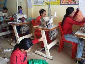 Sreynan working on her sewing skills, using math!