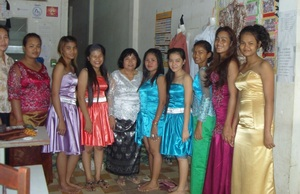Students wearing beautiful dresses they made!