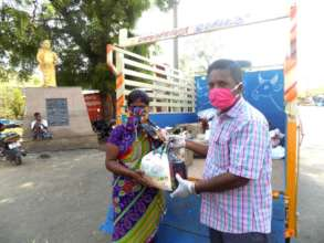 A beneficiary receiving the Groceries Pack