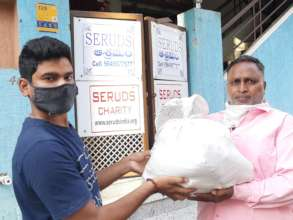 Helping Poor migrant worker with food provisions