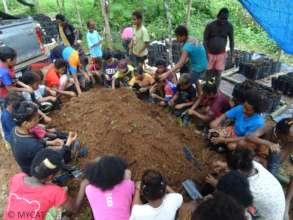 Reforestation work at the Bateq village