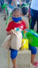 A child receives food, hygiene supplies and a toy!