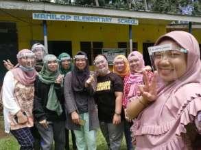 Teachers wearing face provided by AAI