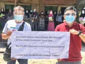 Face shields, masks, and liquid soap help teachers