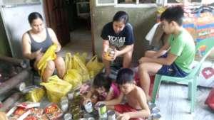 AAI volunteers make Care Packages for kids in need