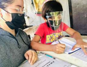 Teachers mentor students with full PPE gear