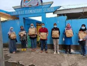 Parents pick up AAI relief packs at Sulu School