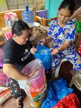 Volunteers packing rice for relief packages