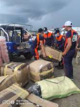 Fire fighters assist AAI carrying incoming aid