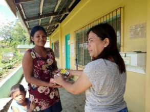 Teachers deliver AAI aid to parents at school