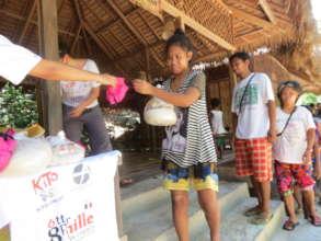 Distribution of food supplies and protective masks