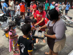 Giving out snacks to the hungry kids