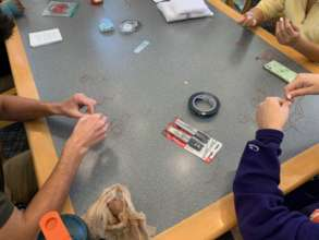 Students making braclets, learn about trafficking