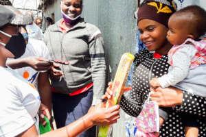 Mukuru family receives hand soap and mask