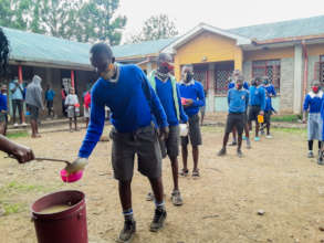 Gatoto students queue for food