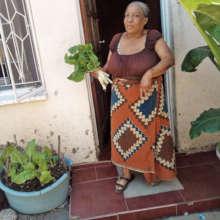 Mirriam sells her crops to help her neighbors