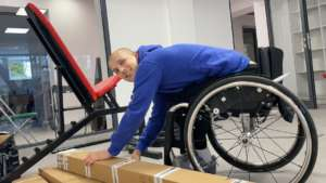 Matthew unpacking rehabilitation equipment.
