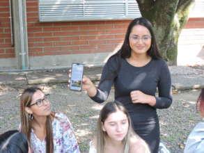 Presenting to her peers