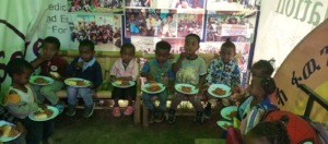 Feeding children in our free daycare