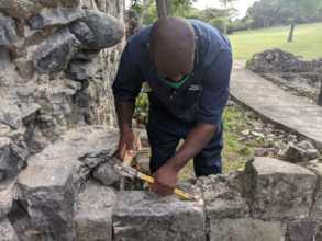 Repairing ruins at Pigeon Island