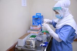 Lab Technician is working at Al Awda Hospital Lab.
