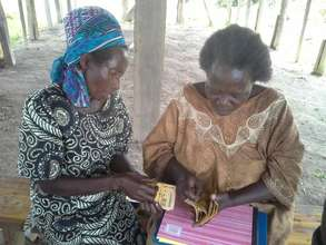 Granny Group leaders managing funds for loans