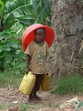 Joyce's grandson fetching water from the well