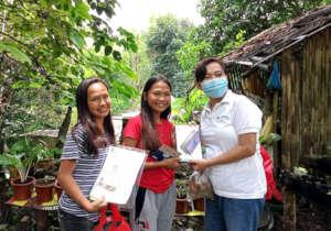 Sarah distributing tablets around Cebu Island