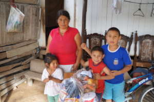 Happy Families Receiving Food Aid